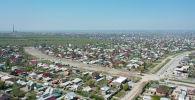 Вид на жилмассив Арча-Бешик на окраине Бишкека. Архивное фото