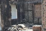 Сгоревшее здание в селе Максат, после конфликта с Таджикистаном