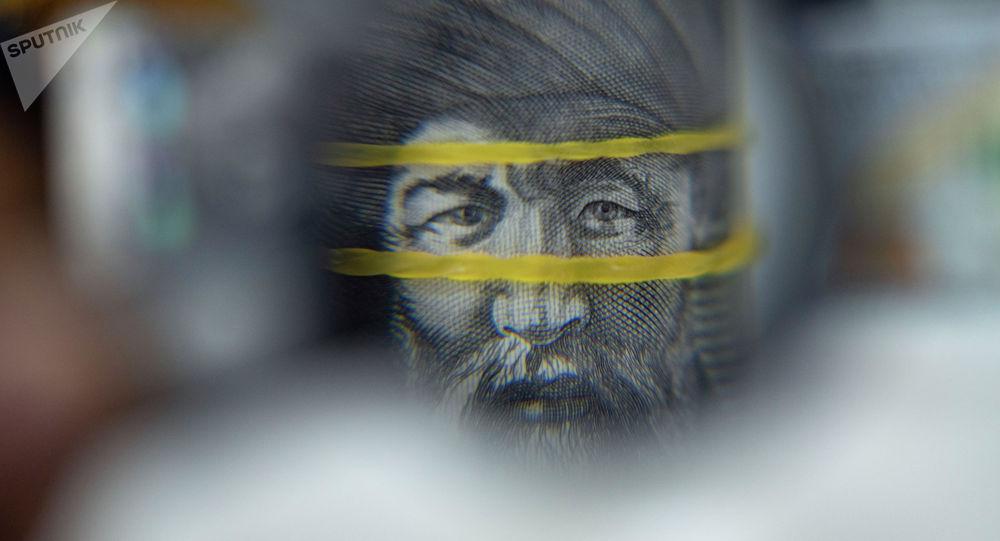 Жусуп Баласагын бирмиң сом купюрада. Иллюстративдик сүрөт