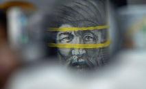 Джусуп Баласагын на тысячесомовой купюре. Иллюстративное фото