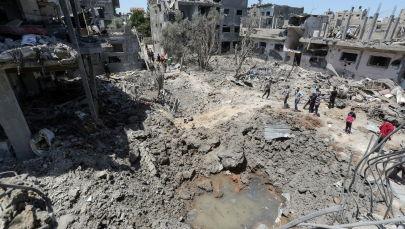 На месте разрушенных домов после израильских авиационных и артиллерийских ударов в северной части сектора Газа. 14 мая 2021 года