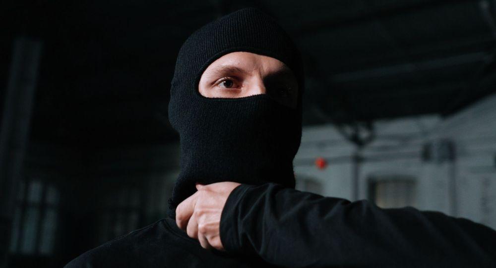 Преступник в маске. Иллюстративное фото