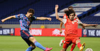 Квалификационный футбольный матч группы F между Японией и Таджикистаном в Суйте, префектура Осака