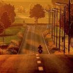 Мотоциклист едет по дороге на окраине Франкфурта, Германия. 14 июня 2021 года