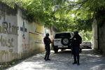 Гаити президенти Жовенел Моиздин резиденциясынын жанында турган полиция кызматкерлери