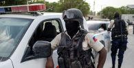 Гаити полиция кызматкери. Архивдик сүрөт