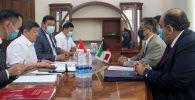 Подписание кредитного соглашения между Кыргызской Республикой и Кувейтским фондом арабского экономического сотрудничества относительно проекта реконструкции Иссык-Кульской кольцевой автодороги на участке Корумду-Балбай