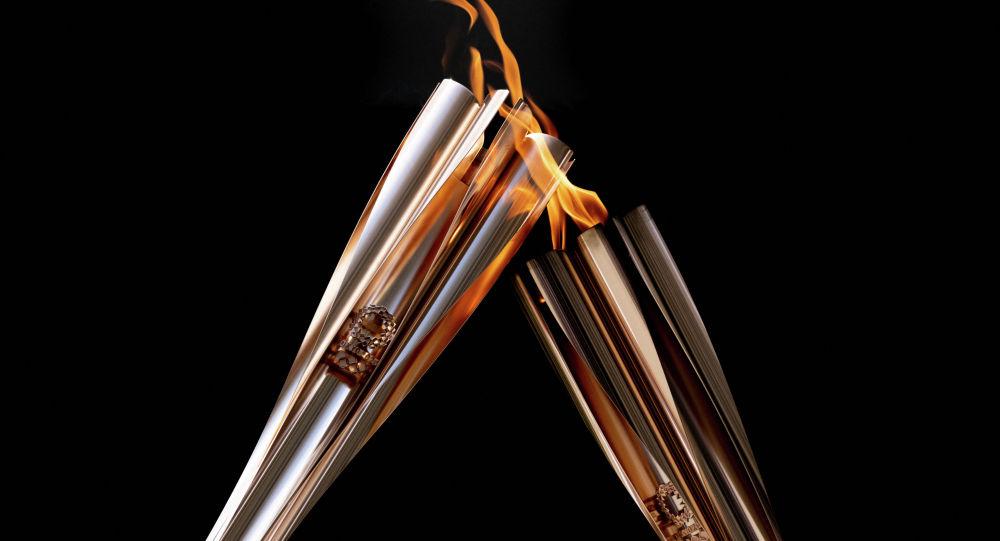 Факелы с олимпийским огнем в Токио