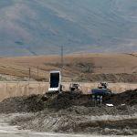 Карьерные самосвалы на территории Таласского золоторудного комбината в Кыргызстане