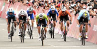 Участники велогонки среди мужчин на XXXII Олимпийских играх в Токио. Архивное фото