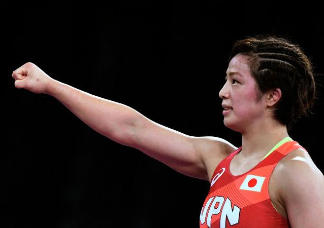 Юкако Каваи празднует победу после победы на Олимпийских играх в Токио-2020. 03 августа 2021 года
