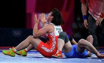 Мээрим Жуманазарова после победы над Батцэцэг Соронзонболд в матче за бронзовую медаль на Олимпийских играх 2020 года в Токио