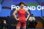 Чемпионка мира по борьбе Айсулуу Тыныбекова перед схваткой. Архивное фото