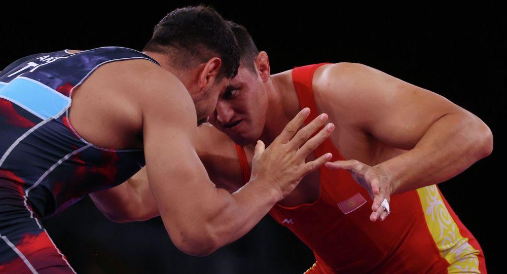 Айаал Лазарева в схватке против Тахи Акгюля на Олимпийских играх в Токио-2020