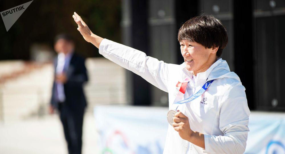 Олимпиада оюндарынын күмүш байге ээси Айсулуу Тыныбекова. Архив