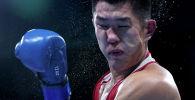 Казахстанский боксе Бекзад Нурдаулетов во время боя на Олимпийских играх в Токио