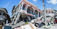 Гаитидеги жер титирөөдөн кыйраган үйлөр