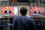На экранах представлены комментарии президента США Джо Байдена о кризисе в Афганистане на сайте Nasdaq MarketSite на Таймс-сквер в Нью-Йорке. США, 16 августа 2021 года