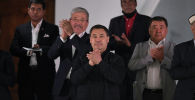 Президент Садыр Жапаров на трибунах стадиона во время матча Кыргызстан — Бангладеш