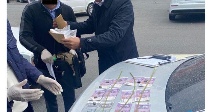 Меченные купюры при задержании лейтенанта милиции А. Т. 06 октября 2021 года