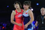 Кыргызстанская спортсменка Мээрим Жуманазарова во время мачтча с японкой Рин Мьядзи