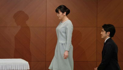 Япониялык ханбийке Мако жолдошу Кей Комуро менен. Архив