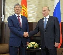 Архив: Путин и Атамбаев во время встречи в Бочаров ручей.