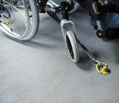 Майып адамдын коляскасы. Архив