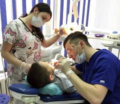 Врач стоматологической клиники DentArex Фархад Асадов