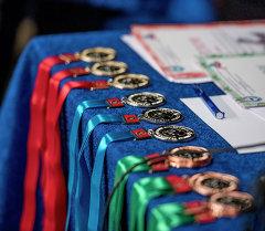 Спортчулардын медальдары. Архив