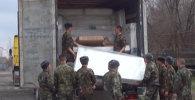 125 кг героин табылган автомашинаны тинтүү учурунда тартылган ыкчам тасма