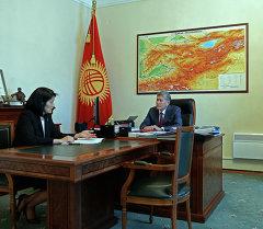 Президент Алмазбек Атамбаев жана Эльвира Сариева