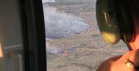 Яценюк пролетел на вертолете над горящей зоной отчуждения Чернобыльской АЭС