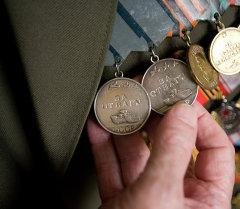Согуш ардагеринин медальдары. Архив