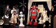 Первая в мире свадьба роботов состоялась в Токио. Смотрите на видео, как необычные новобрачные обменялись поцелуем.