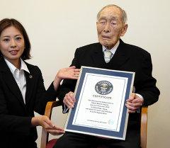 Гиннестин рекорддор китеби боюнча жер шарынын эң улгайган жашоочусу, Япониянын Саитама префектурасынын тургуну Сакари Момои. архив