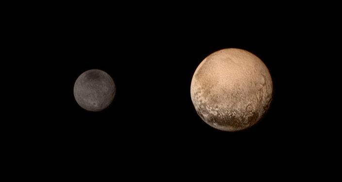 Новый цветной портрет пары Плутона и Харона. Архивное фото