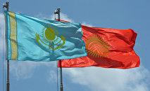 Кыргызстан жана Казахстан желектери. Архивдик сүрөт