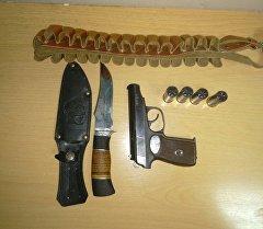 Обнаруженный у гражданина Казахстана газовый пистолет и патроны к гладкоствольному оружию.