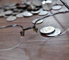 Көз айнек жана монеталар. Архив