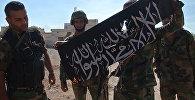 СПУТНИК_Освобождение Атшана: ликование сирийских солдат и сожжение флага боевиков