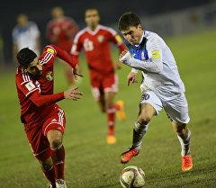 Футболисты сборной Кыргызстана и Иордании во время матча в Бишкеке. Архивное фото