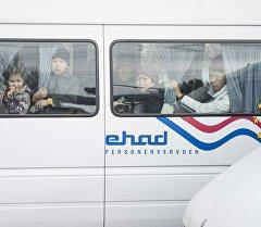 Маршруттук таксидеги жүргүнчүрлөрдүн архивдик сүрөтү