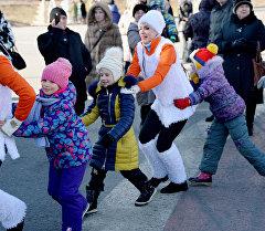 Жители на Рождественских гуляниях. Архивное фото