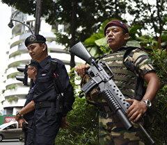Куала-Лумпур шаарынын полиция кызматкерлери. Архив