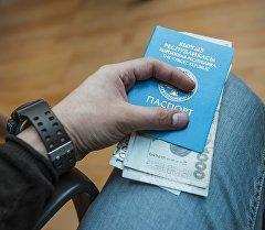 Паспортко салынган акча. Архив