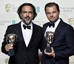 Актер Леонардо ди Каприо менен тасманын режиссеру Алехандро Гонсалес Иньярритуго.
