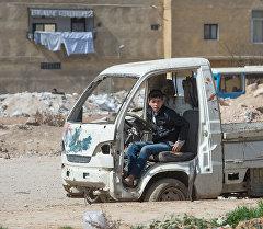 Мальчик на одной из улиц Дамаска. Архивное фото