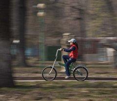 Велосипед тепкен кыз. Архив