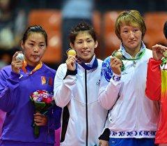 Азия чемпиону Айсулуу Тыныбекова Инчхондо коло медалы менен. Архив